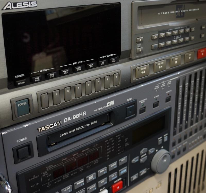 Rack of three digital multi-track machines