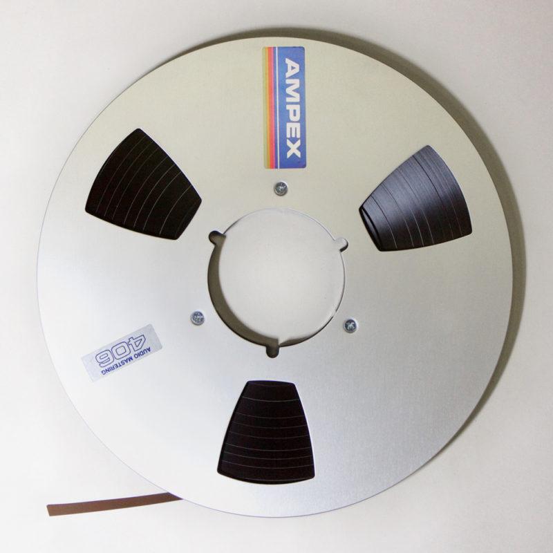 Aluminium Ampex 10.5 inch mastering spool, with quarter inch brown magnetic tape