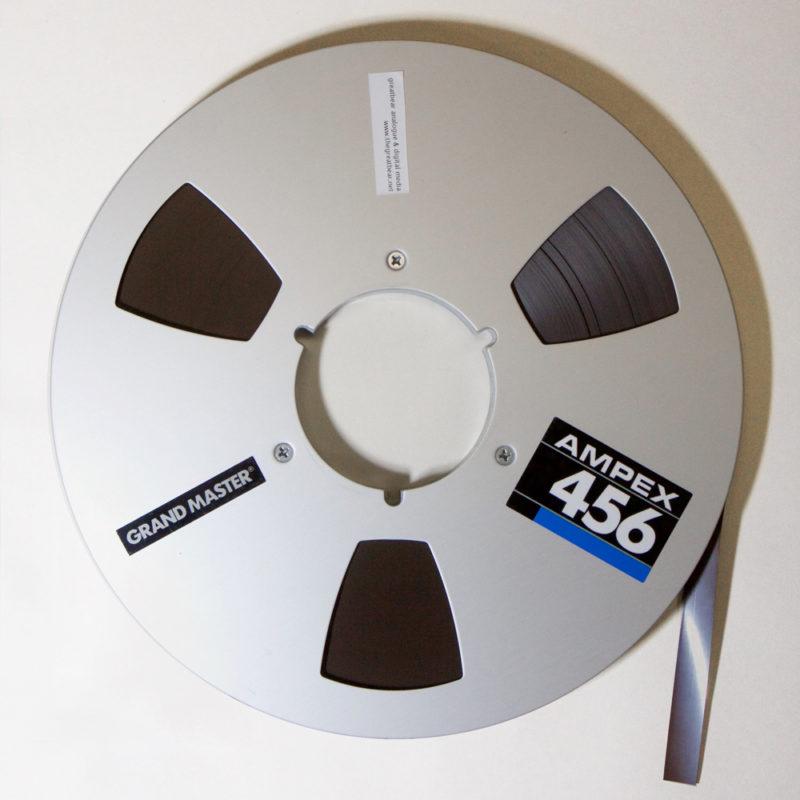 Aluminium Ampex spool with half inch brown magnetic tape